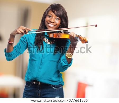 cool black woman playing violin - stock photo