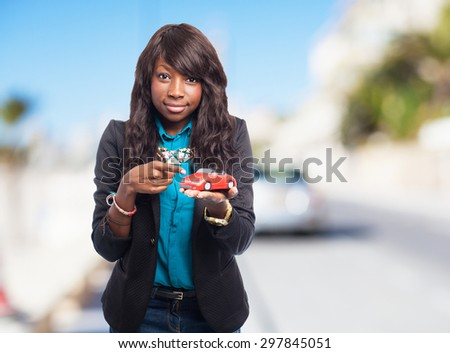 cool black woman with red car - stock photo