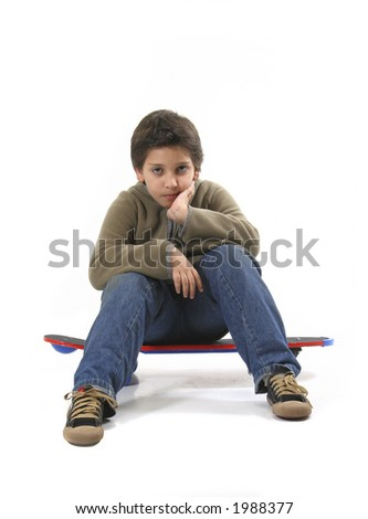 Cool boy sitting on a skate. Full body, white background.