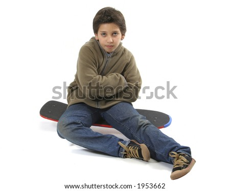Cool boy sitting on a skate. Full body, white background. More pictures of this model at my gallery
