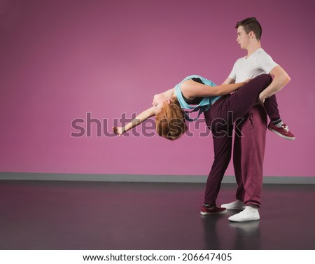 Cool break dancing couple dancing together in the dance studio - stock photo