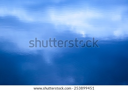 Cool breeze comes sweeping over the lake - stock photo