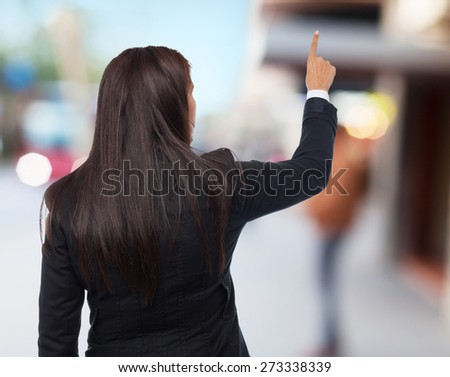 cool business-woman pointing up - stock photo