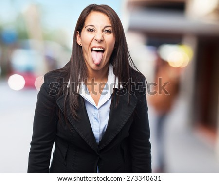 cool business woman showing tongue - stock photo