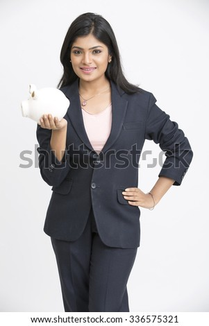 Cool business woman with piggy-bank on white - stock photo