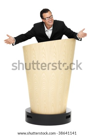 Cool businessman welcome you on lectern on isolated white - stock photo