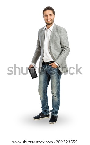 Cool businessman with tablet PC in his hand -Full length portrait isolated on white, including clipping path - stock photo