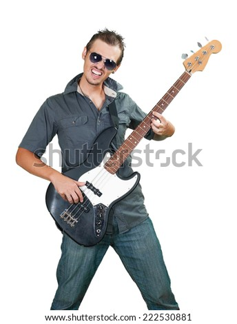 Cool caucasian bass guitar player wearing sun glasses - stock photo