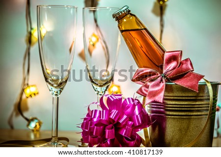 Cool Champagne and glass prepare for Celebration. Candle is lighting in a candlestick in Christmas and New year festival. - stock photo