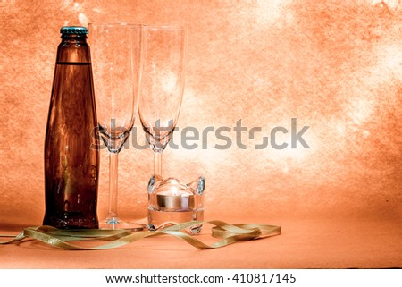 Cool Champagne in ice bucket and a couple glass. Candlestick and ribbon ornament for Celebration festival. - stock photo