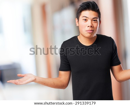 cool chinese-man doubting - stock photo