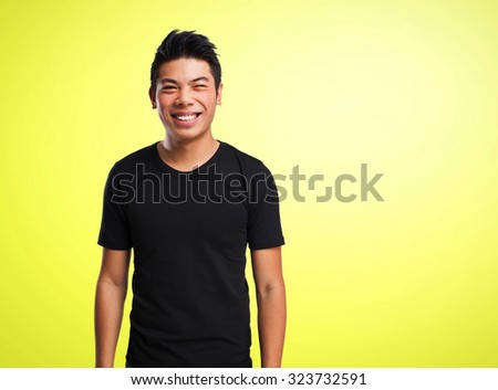 cool chinese man smiling - stock photo