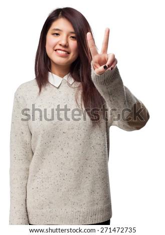 cool chinese-woman victory-gesture - stock photo