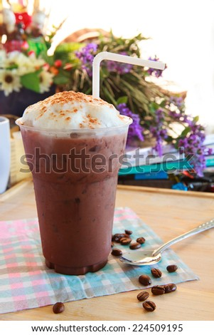 cool chocolate with milk smooth bubble on top in bottle ready to eating - stock photo