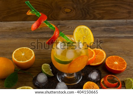 Cool citrus cocktail on wooden table. Fruit cocktail. Fruit drink. Citrus lemonade. Fruit lemonade. Summer drink  - stock photo