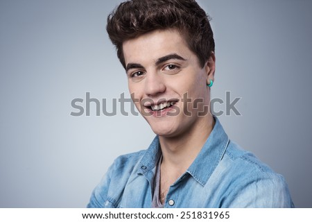 Cool confident guy smirking and looking at camera - stock photo