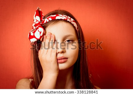 cool cute little girl closes one eye by an ophthalmologist - stock photo