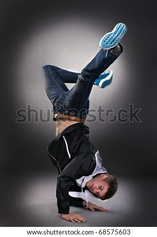 cool dancer man on gray background