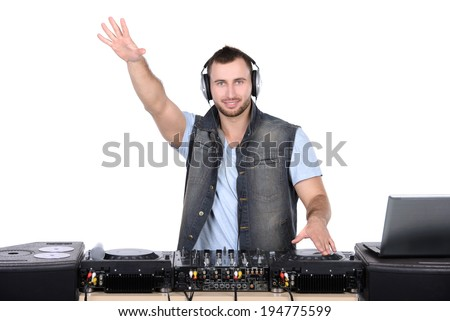 Cool DJ at work. Happy young men spinning on turntable while isolated on white - stock photo