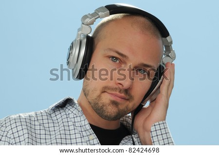 Cool DJ with Headphones in front of blue Sky - stock photo
