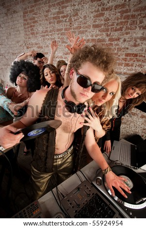Cool DJ with vest and female admirers - stock photo