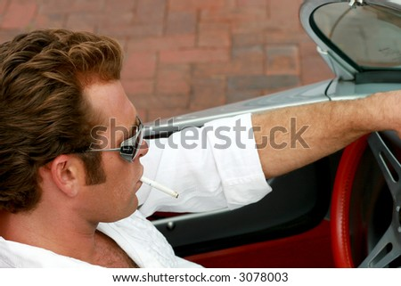 cool dude driving a sports car