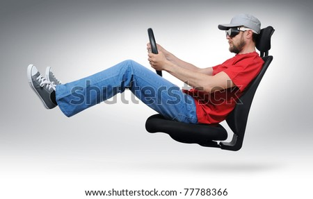 Cool dude with the wheel flies on an office chair concept - stock photo
