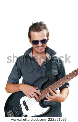Cool european bass guitar player wearing sun glasses - stock photo