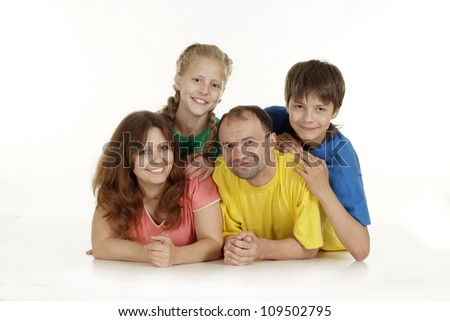 Cool family of four in bright T-shirt on a white background