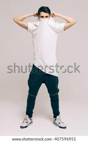 Cool fashion male model posing. Street youth fashion. Studio. Indoor. - stock photo