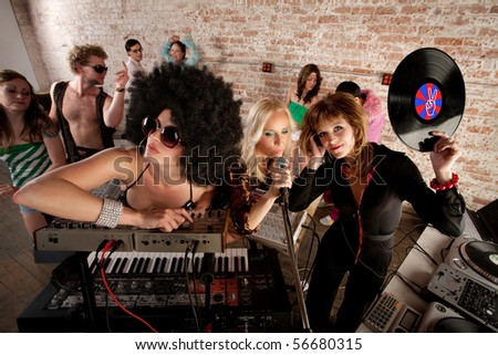 Cool female DJs performing at a 1970s Disco Music Party - stock photo