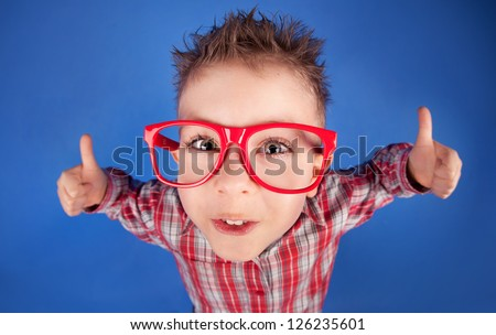 Cool five years old boy showing ok sign - stock photo