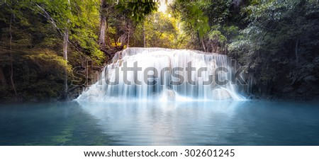 Cool fresh water pond in forest with smooth and silky waterfall cascades. Nature background panorama - stock photo