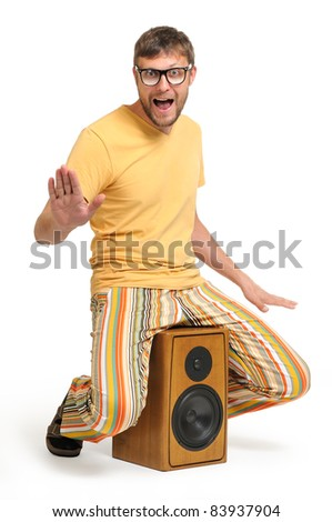 Cool funny dude dancing while sitting on the speaker white background, musical concept - stock photo