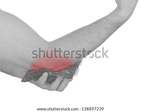 Cool gel pack on a swollen hurting elbow. Medical concept photo.  Color Enhanced skin with read spot indicating location of the pain. - stock photo