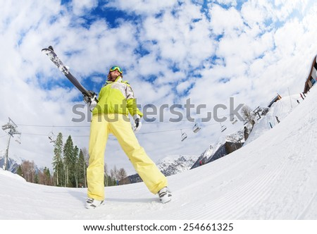 Cool girl in mask standing and holding ski - stock photo