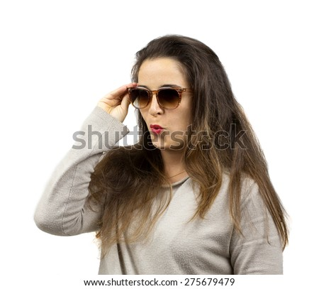cool girl with sunglasses and long hair over white background - stock photo