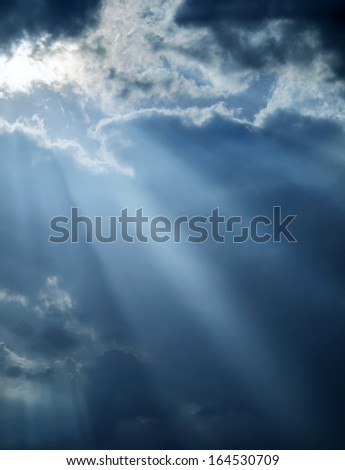 Cool God light breaks dark clouds  - stock photo