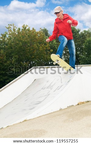 Cool granny on a skateboard at a skatepark