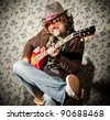 Cool guitar player rocking out solo on the guitar - stock photo