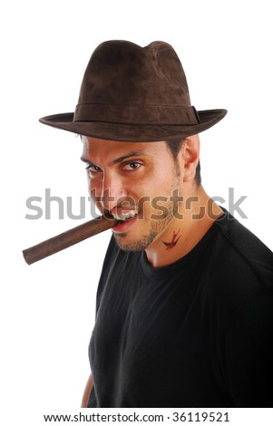 Cool guy in a hat with a cigar - stock photo