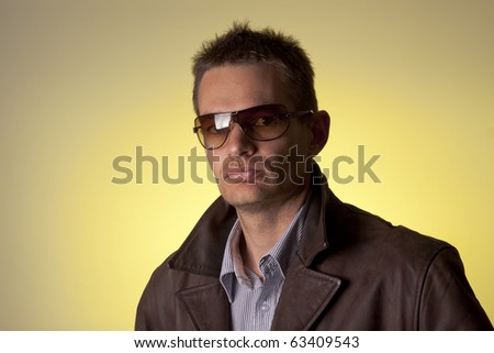 Cool guy in leather jacket and sunnies - stock photo