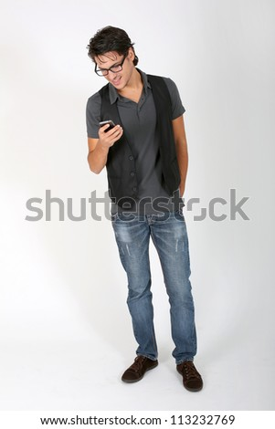 Cool guy on white background with smartphone - stock photo