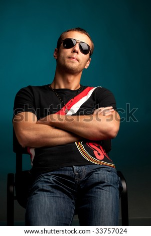 cool guy wearing sunglasses - stock photo