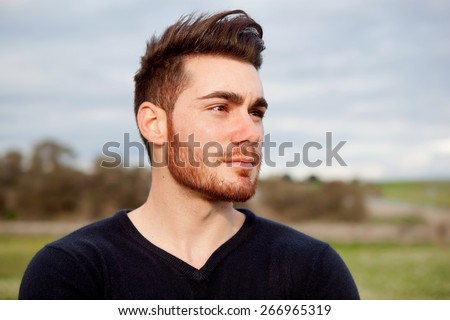 Cool handsome guy with beard at outside - stock photo