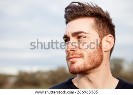 Cool handsome guy with beard smiling - stock photo