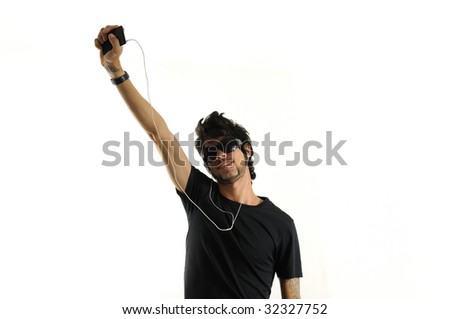 Cool handsome hispanic man listening to music with headphones - isolated - stock photo