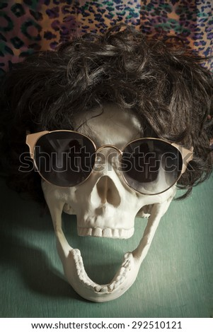 Cool human skull relaxing like a rock star