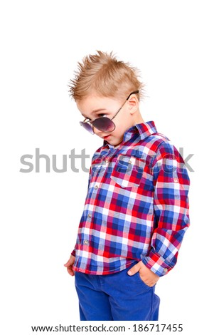 Cool little boy on a white background isolated