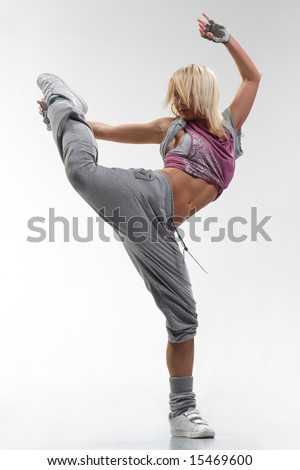 cool looking and stylish hip-hop dancer posing on white background